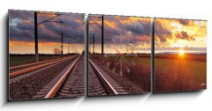 Obraz s hodinami 3D třídílný - 150 x 50 cm F_BM81148616 - Orange sunset in low clouds over railroad